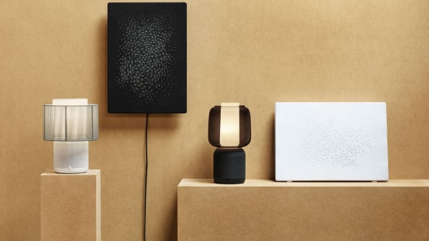 a-white-lamp-and-a-black-lamp-with-speakers-built-in-next-to-2068e74b09c95195666b06dbb84de8bf
