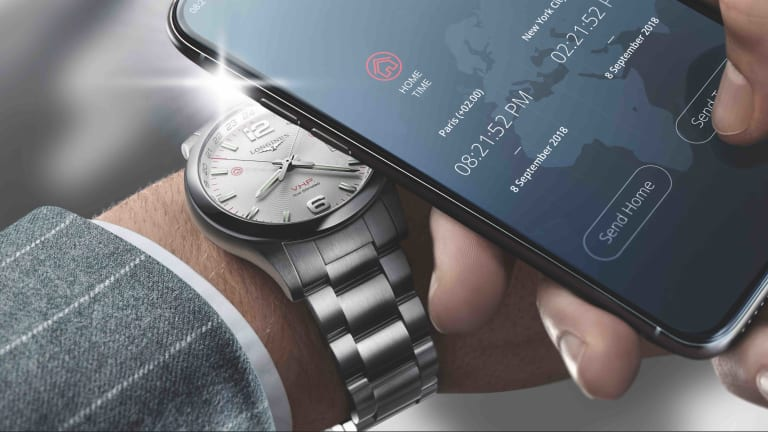 Longines' new watch can sync its time zone by using the flash on your smartphone camera