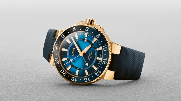 Oris' new limited edition Aquis is the brand's first solid gold timepiece