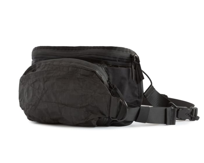 Outlier's new bag fits like a compact chest bag and can expand to fit a laptop