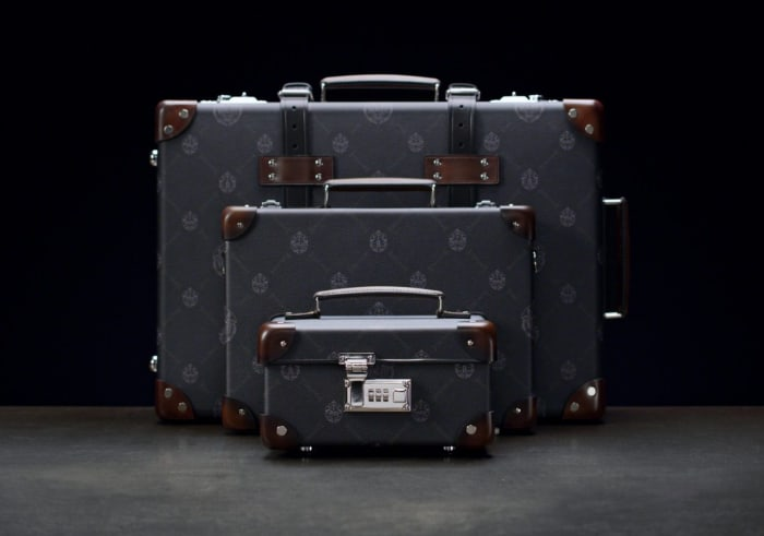 Berluti is wrapping a new collection of Globe-Trotter luggage in their signature canvas