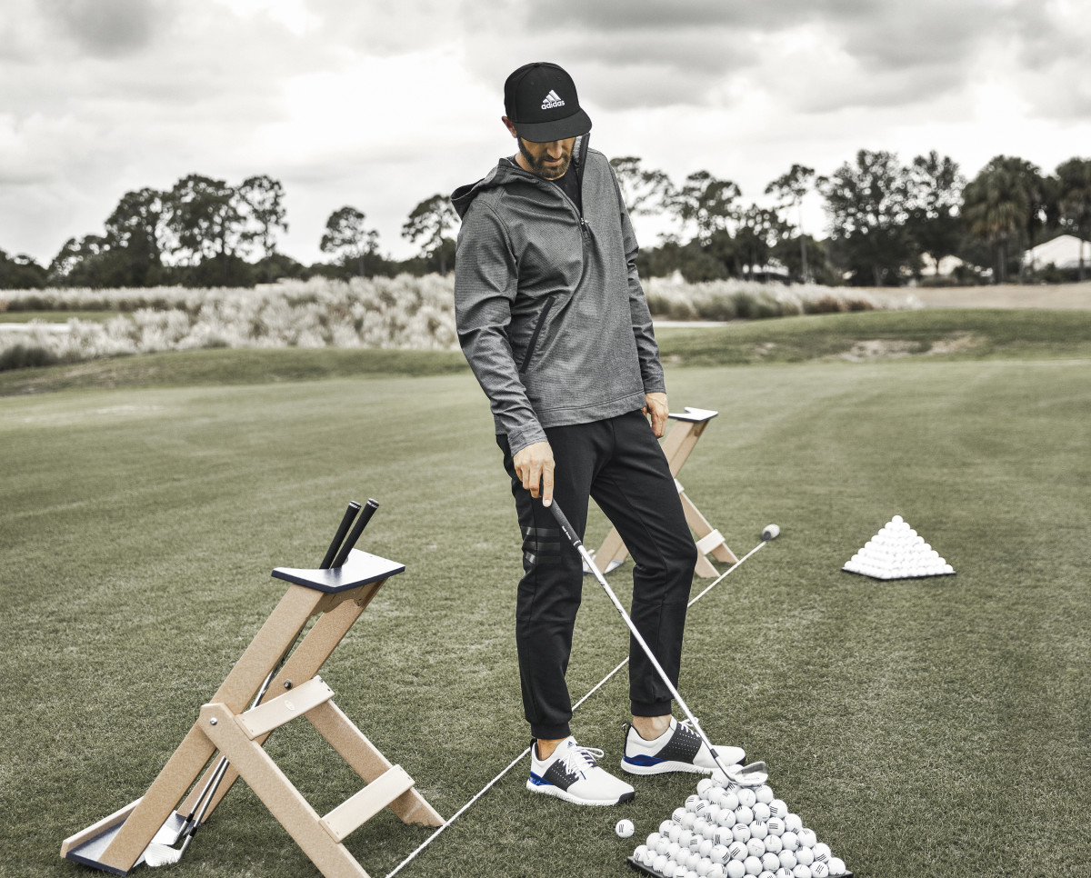 Golfer Dustin Johnson wearing the the adicross Anorak, Jogger, and Bounce shoes.