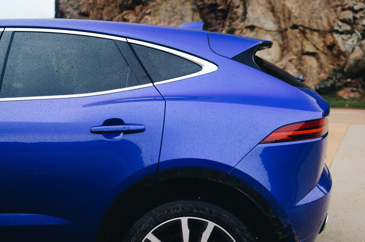 The haunches and the rake of the rear glass are two of the car's most striking elements.